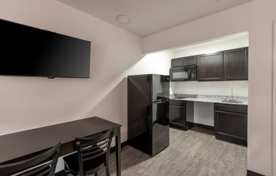 Welcome To Suburban Extended Stay - Kitchen and Dining Area